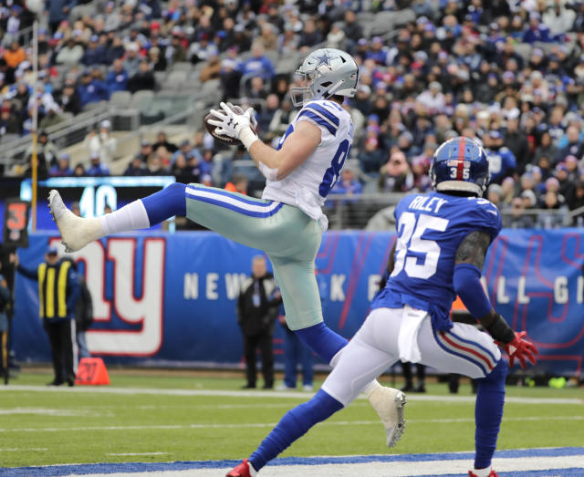 Dallas Cowboys' Blake Jarwin, left, catches a pass in the end zone during the first half of an NFL football game against the New York Giants, Sunday, Dec. 30, 2018, in East Rutherford, N.J. (AP Photo/Frank Franklin II)
