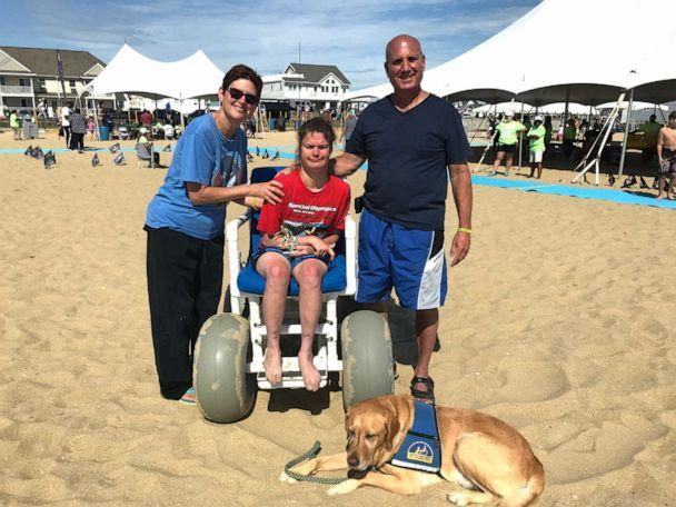 PHOTO: Bethy De Tata pictured with her parents Jim and Sue De Tata at the Autism Beach Bash in Belmar, New Jersey. (ABC News)
