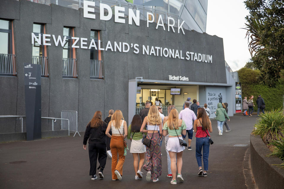 Fans arrive for Eden Park where New Zealand band Six60 is scheduled to perform in Auckland, New Zealand, Saturday, April 24, 2021. New Zealand band Six60 is being billed as the biggest live act in the world since the coronavirus pandemic struck after New Zealand stamped out the spread of the virus, allowing life to return to normal. On Saturday, the band will play a remarkable finale to their latest tour, performing in front of 50,000 people at the first-ever concert at Auckland's Eden Park. (AP Photo/David Rowland)