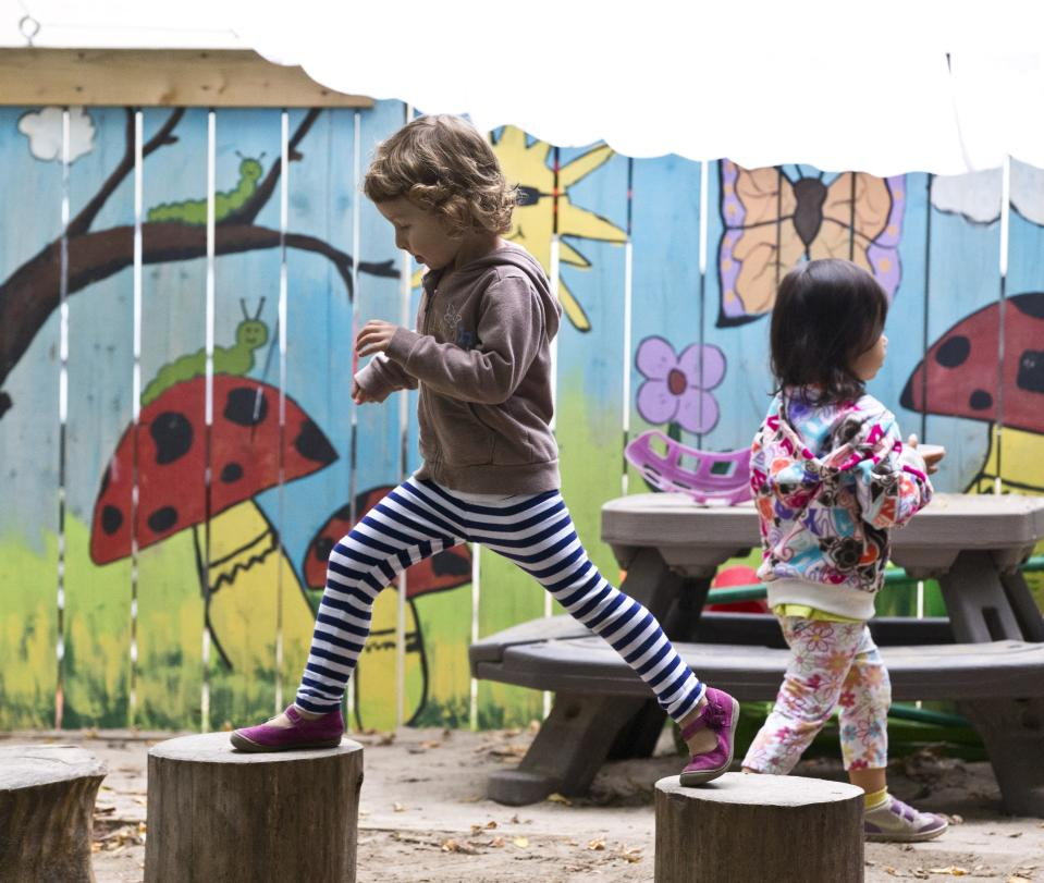 TORONTO, ON - SEPTEMBER 30:  Children enrolled in the University of Toronto Co-op Day Care play outside Tuesday September 30, 2014 before Toronto mayoral candidate Olivia Chow released her child care platform.        (Tara Walton/Toronto Star via Getty Images)