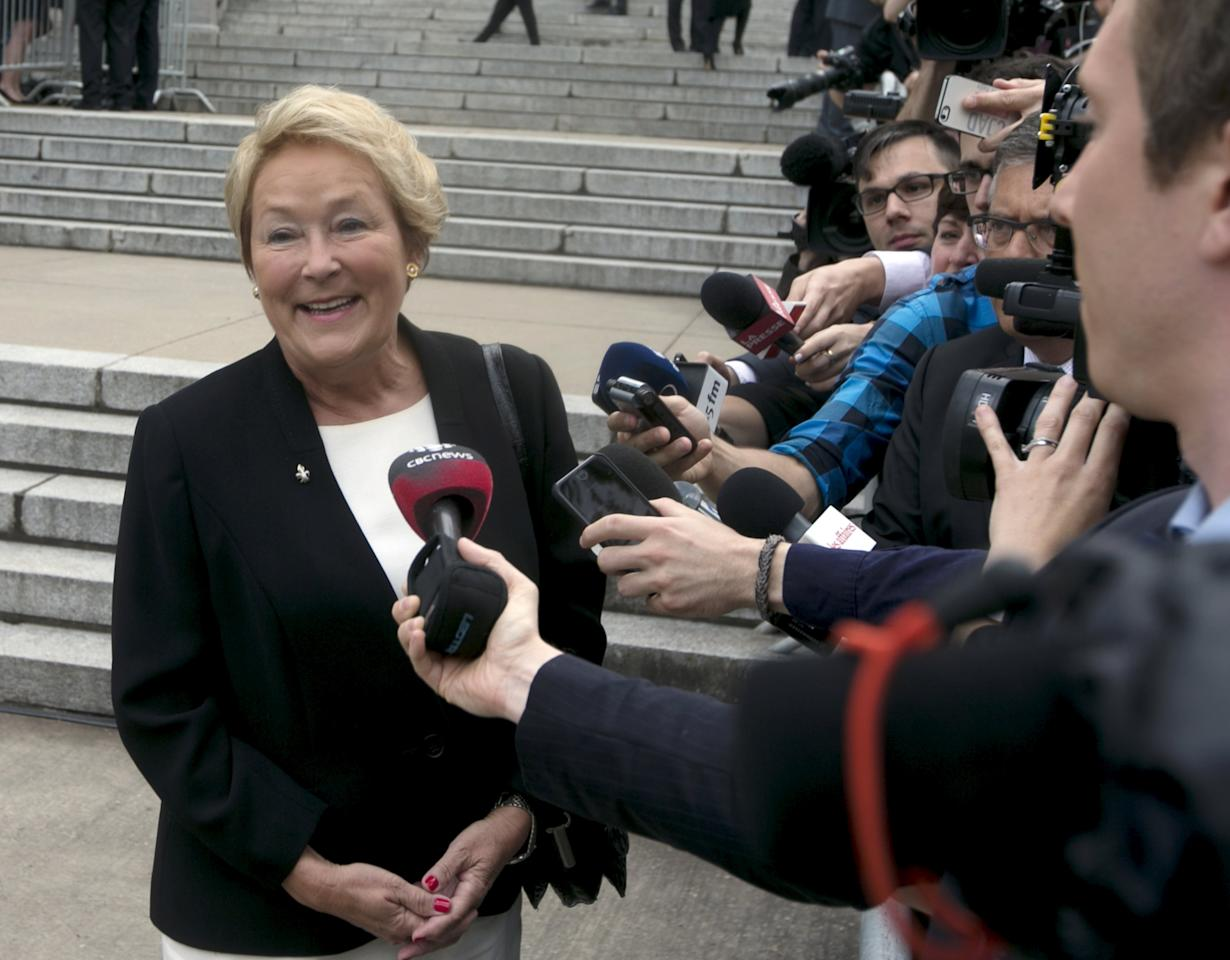 Former Quebec Premier Pauline Marois smiles as the crowds cheer upon her arrival for the funeral Jacques Parizeau at Saint-Germain-D'Outremont Church in Montreal June 9, 2015.  Parizeau died on June 1 at the age of 84.  REUTERS/Christinne Muschi