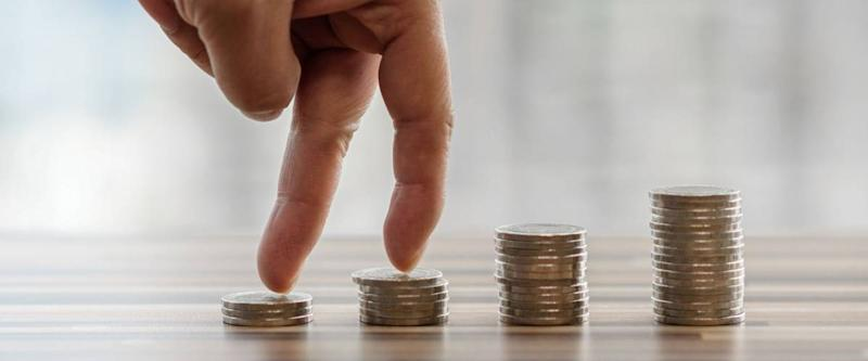 Hand with fingers business man putting on coin and looking for profit growth up, Collect money with earning bank deposit interest