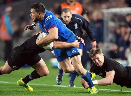 Rugby Union - June Internationals - New Zealand vs France - Eden Park, Auckland, New Zealand - June 9, 2018 - France's Remy Grosso is tackled by New Zealand's Jordie Barrett. REUTERS/Ross Setford