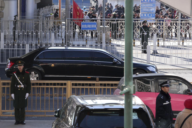 A stretch limousine with a golden emblem, similar to one North Korean leader Kim Jong Un has used previously, is seen leaving the train station with a convoy in Beijing, China, Tuesday, Jan. 8, 2019. While President Donald Trump waits in the wings, North Korean leader Kim Jong Un arrived in Beijing on Tuesday for his fourth summit with China's Xi Jinping, yet another nod to the leader Kim most needs to court as he tries to undermine support for international sanctions while giving up little, if any, ground on denuclearization. (AP Photo/Ng Han Guan)