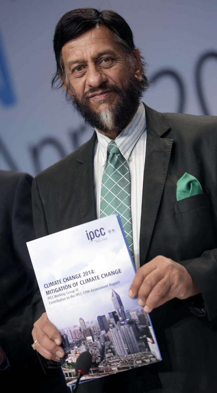 Rejendra K. Pachauri, Chairman of the IPCC, from left, poses prior to a press conference as part of a meeting of the Intergovernmental Panel on Climate Change (IPCC) in Berlin, Germany, Sunday, April 13, 2014. The panel met from April 7, 2014 until April 12, 2014 in the German capital. (AP Photo/Michael Sohn)