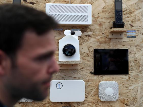 An attendee passes a display of Nest products during Google I/O 2016 at Shoreline Amphitheatre on 19 May, 2016 in Mountain View, California (Getty Images)
