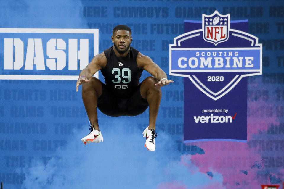 FILE - In this March 1, 2020, file photo, Utah defensive back Terrell Burgess prepares to run the 40-yard dash at the NFL football scouting combine in Indianapolis. Teams are now sending scouts, coaches and general managers across the country for 103 college pro days replacing this year's combine in yet another NFL adaptation to the coronavirus pandemic. (AP Photo/Charlie Neibergall, File)