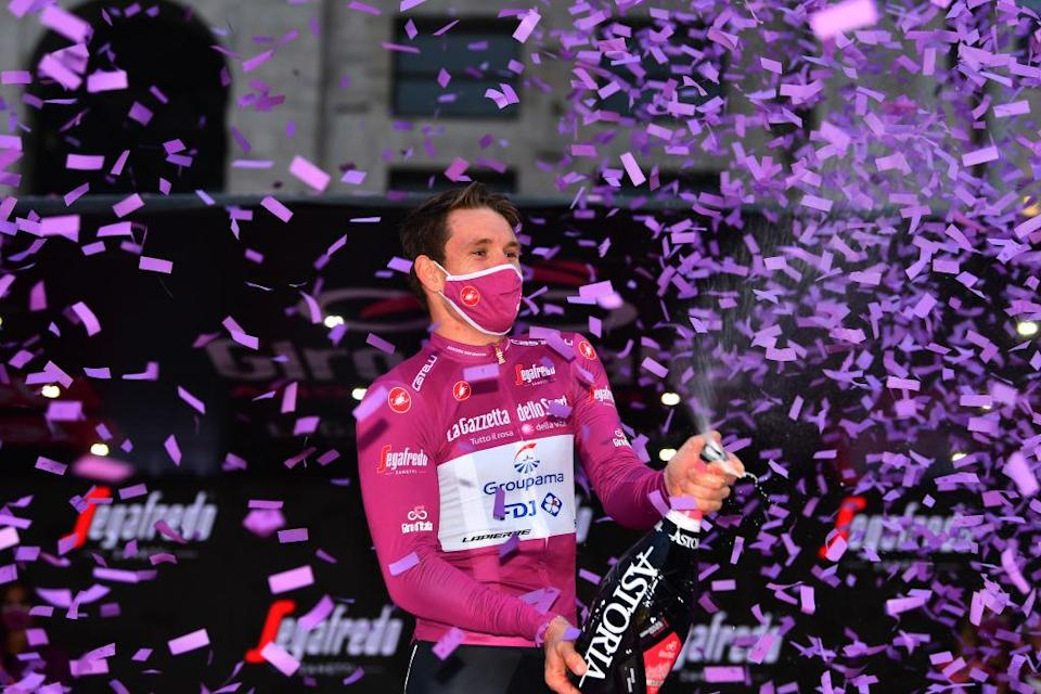 Groupama-FDJ's Arnaud Démare celebrates winning the cyclamen points jersey in Milan at the finish of the 2020 Giro d'Italia