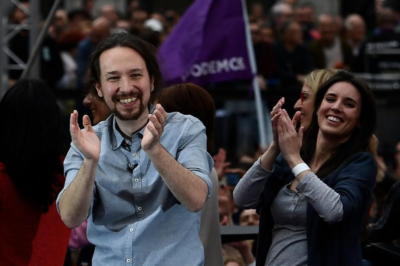 Spanish far-left Podemos party leader Pablo Iglesias (L) and Podemos MP Irene Montero attend a pre-campaign rally in Madrid on March 23, 2019 ahead of general elections on April 28, and regional, local and European Parliament elections on May 26. (Photo by PIERRE-PHILIPPE MARCOU / AFP) (Photo credit should read PIERRE-PHILIPPE MARCOU/AFP via Getty Images)