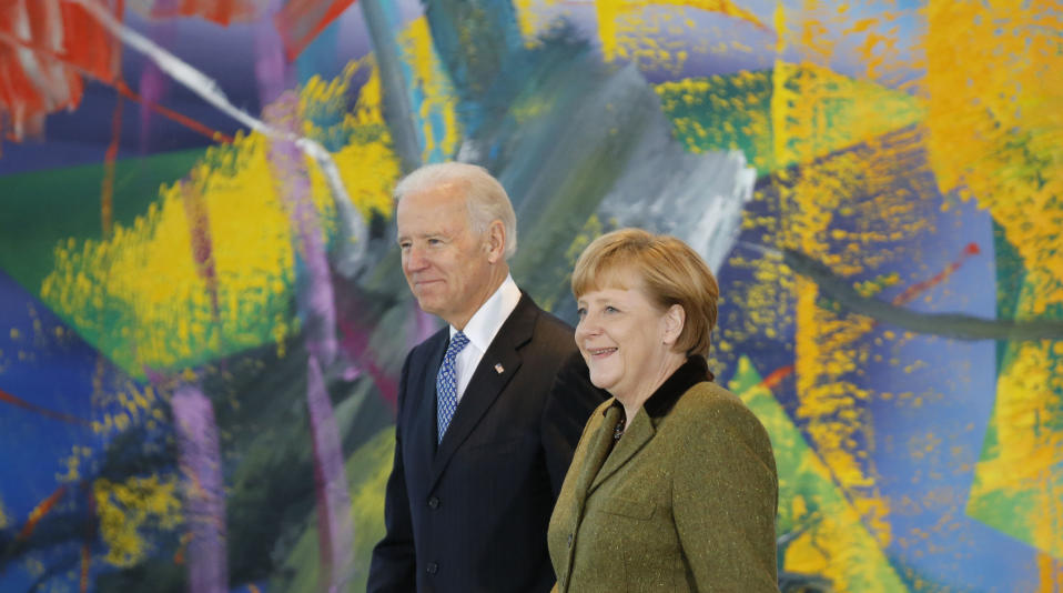 German Chancellor Angela Merkel and U.S. Vice President Joe Biden arrive to make a statement to the media before talks in Berlin February 1, 2013. REUTERS/Tobias Schwarz (GERMANY - Tags: POLITICS)