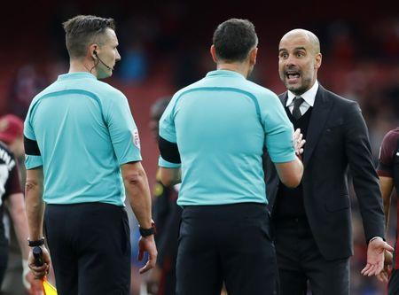 Britain Football Soccer - Arsenal v Manchester City - Premier League - Emirates Stadium - 2/4/17 Manchester City manager Pep Guardiola speaks to referee Andre Marriner at full time Reuters / Eddie Keogh Livepic