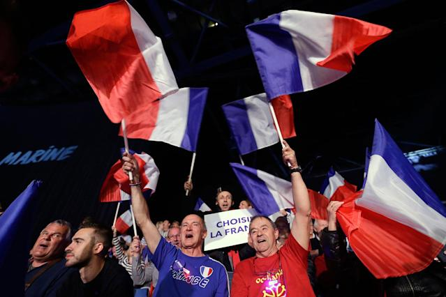 "<p>Supporters wave French flags prior to an election campaign rally of French far-right leader and presidential candidate Marine Le Pen in Nice, southern France, Thursday April 27, 2017. After ""the battle of Whirlpool,"" when Marine Le Pen and Emmanuel Macron both went hunting for France's blue-collar vote at a threatened home appliance factory, the presidential candidates clashed over fish as Le Pen boarded a fishing trawler, in a return to more traditional campaigning on Thursday. (AP Photo/Claude Paris) </p>"
