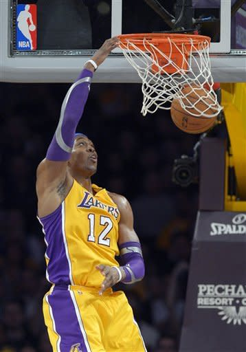Los Angeles Lakers center Dwight Howard dunks during the first half of an NBA basketball game against the against the New Orleans Hornets, Tuesday, Jan. 29, 2013, in Los Angeles. (AP Photo/Mark J. Terrill)
