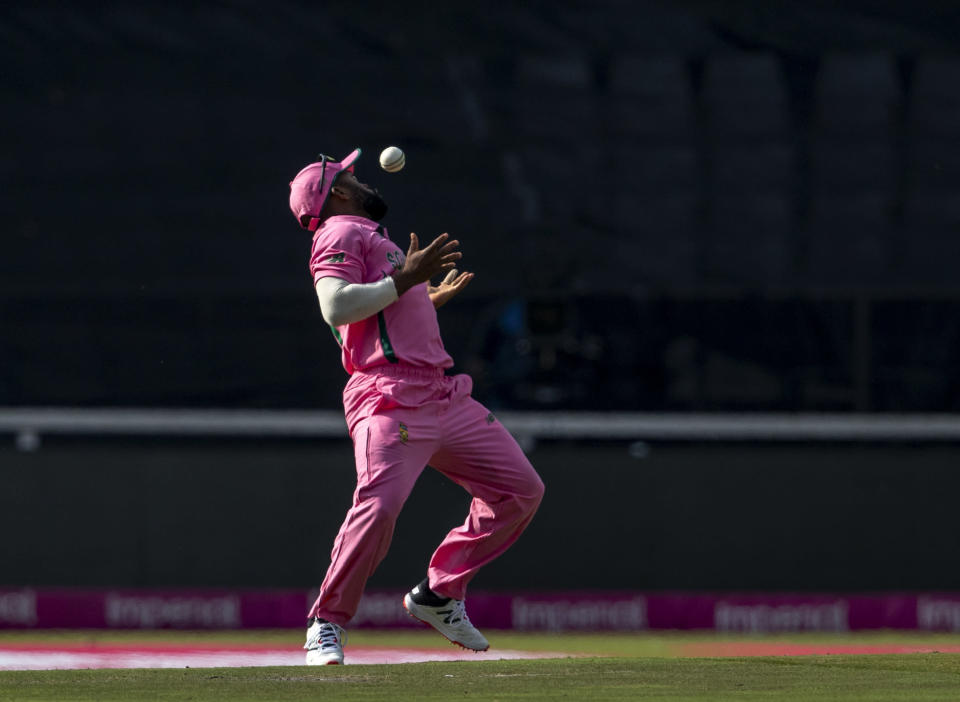 South Africa's captain Temba Bavuma juggles the ball is he takes a catch to dismiss Pakistan's captain Babar Azam for 31 runs during the second One Day International cricket match between South Africa and Pakistan at the Wanderers stadium in Johannesburg, South Africa, Sunday, April 4, 2021. (AP Photo/Themba Hadebe)