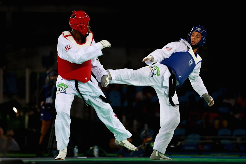 """The U.S. Olympic Committee and USA Taekwondo have been named in a lawsuit by four former female athletes claiming <a class=""""link rapid-noclick-resp"""" href=""""/olympics/rio-2016/a/1124314/"""" data-ylk=""""slk:Steven Lopez"""">Steven Lopez</a>, right, and his brother and team coach, Jean, sexually abused them and both organizations ignored it. (Getty Images)"""