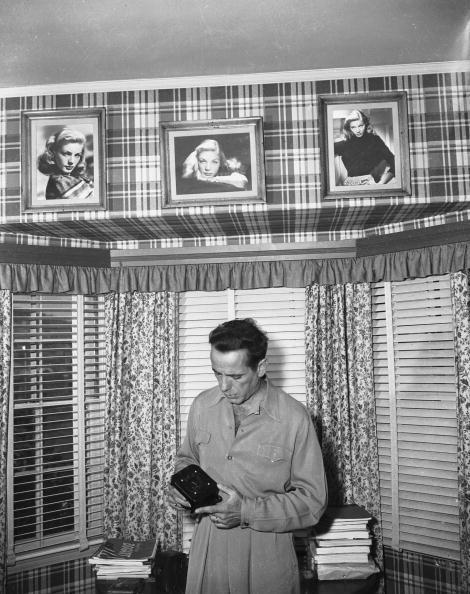 <p>Humphrey Bogart and Lauren Bacall are one of Hollywood's greatest love stories. Even after the whirlwind of their 1945 nuptials, we can tell how much he loved her — just look at his study. Complimenting the plaid wallpaper in the actor's home office are three photographs of a young Lauren. </p>