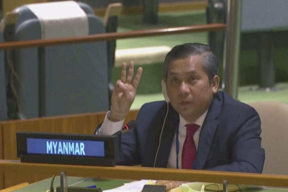 "In this image taken from video by UNTV, Myanmar Ambassador to the United Nations Kyaw Moe Tun flashes the three-fingered salute, a gesture of defiance done by anti-coup protesters in Myanmar, at the end of his speech before the U.N. General Assembly at the United Nations Friday, Feb. 27 , 2021. Myanmar's U.N. ambassador strongly opposed the military coup in his country and appealed for the ""strongest possible action from the international community"" to immediately restore democracy in a dramatic speech to the U.N. General Assembly Friday that drew loud applause from many diplomats in the 193-nation global body. (UNTV via AP)"