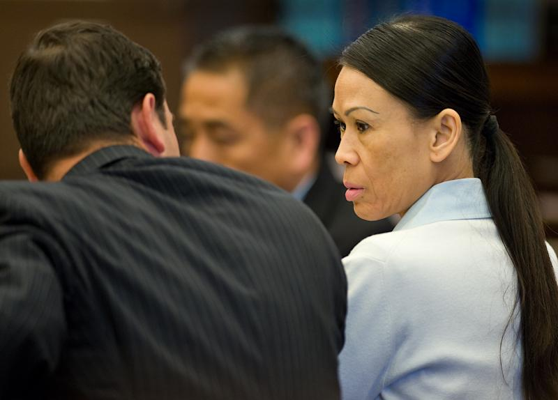 Catherine Kieu sits next to her attorney, deputy public defender, Frank Bittar, before opening statements Wednesday, April 17, 2013 in Santa Ana, Calif.   Kieu is charged with cutting off a man's penis and throwing it into a garbage disposal.  Investigators say Kieu lived with the 60-year-old victim and the pair got into an argument over a future houseguest's visit. Authorities allege that after the man went to sleep, Kieu tied him to the bed and severed the organ. Kieu faces a possible life prison sentence if convicted. (AP Photo/The Orange County Register, )   MAGS OUT; LOS ANGELES TIMES OUT