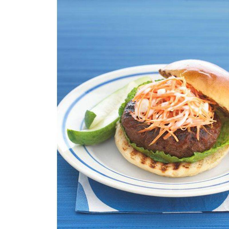 """<p>The chipotle chili-spiked barbecue sauce gives these burgers a flavorful kick.</p><p><a href=""""https://www.womansday.com/food-recipes/food-drinks/recipes/a21318/spicy-barbecue-burgers-carrot-slaw/"""" rel=""""nofollow noopener"""" target=""""_blank"""" data-ylk=""""slk:Get the Spicy Barbecue Burgers With Blue Cheese-Carrot Slaw recipe."""" class=""""link rapid-noclick-resp""""><em>Get the Spicy Barbecue Burgers With Blue Cheese-Carrot Slaw recipe.</em></a></p>"""
