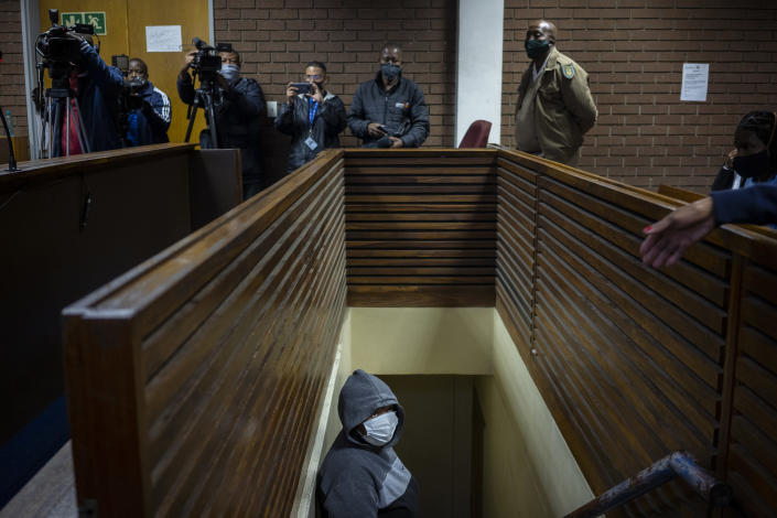 The suspect charged with killing Wandi Zitho waits to enter the courtroom in Vereeniging, South Africa, on Oct. 12, 2020. She was released and the case against her was provisionally dropped because the police didn't deliver enough evidence. Months later, the woman was arrested again and charged with murdering two other children. (AP Photo/Bram Janssen)