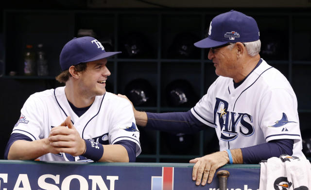 Tampa Bay Rays manager Joe Maddon, right, speaks with right fielder Wil Myers before the start of Game 3 of an American League baseball division series against the Boston Red Sox, Monday, Oct. 7, 2013, in St. Petersburg, Fla. (AP Photo/Mike Carlson)
