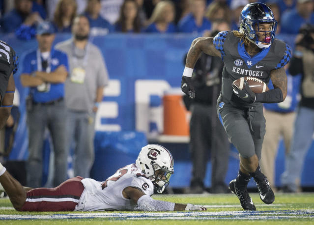 Kentucky quarterback Terry Wilson (3) rushes with the ball during the first half of an NCAA college football game against South Carolina in Lexington, Ky., Saturday, Sept. 29, 2018. (AP Photo/Bryan Woolston)