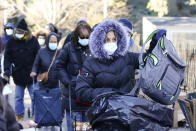 """People wait on a line for food donations at the annual """"Hunts Point Give Back"""" Wednesday, Nov. 18, 2020, in New York. Merchants at the Hunts Point Produce Market will provide people in the metropolitan area with seasonal produce in advance of Thanksgiving. (AP Photo/Frank Franklin II)"""