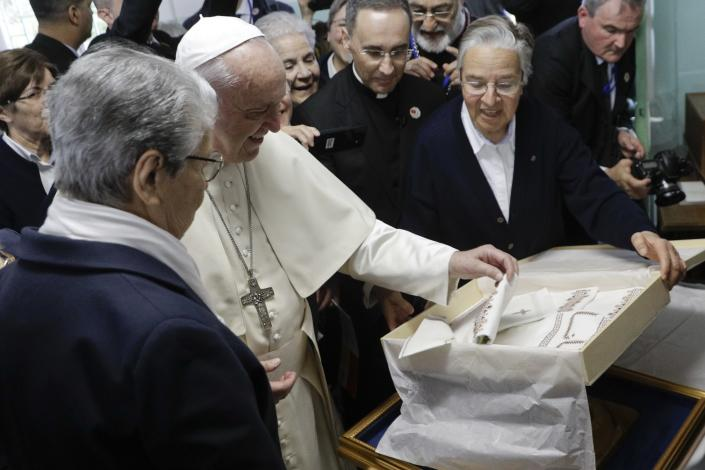 Pope Francis exchanges gifts during a visit to the Rural Center for Social Services at Temara, south of Rabat, Morocco, Sunday, March 31, 2019. Pope Francis is in Morocco for a two-day trip aimed at highlighting the North African nation's Christian-Muslim ties, while also showing solidarity with migrants at Europe's door and tending to a tiny Catholic flock. (AP Photo/Gregorio Borgia)