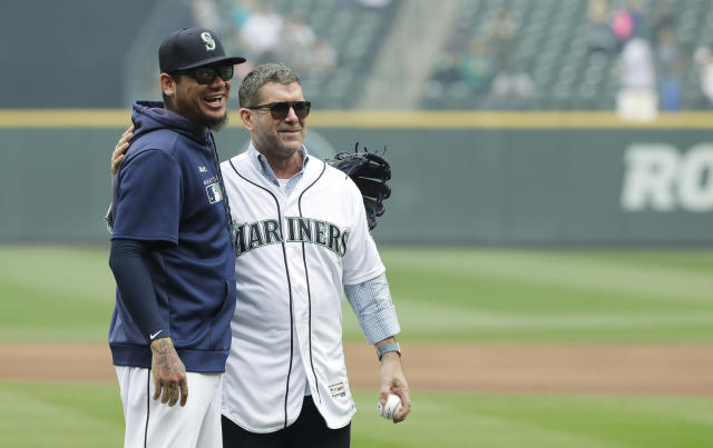 Seattle Mariners Hall-of-Famer and former designated hitter Edgar Martinez, right, poses for a photo with pitcher Felix Hernandez, left, after Hernandez caught Martinez throwing out the first pitch of a baseball game against the Tampa Bay Rays, Sunday, Aug. 11, 2019, in Seattle. (AP Photo/Ted S. Warren)