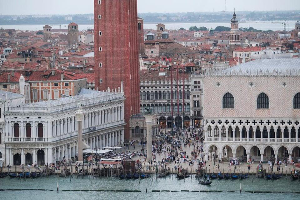 Venice lawmakers have approved new measures and proposed the charges will start from summer 2022 onwards (REUTERS)