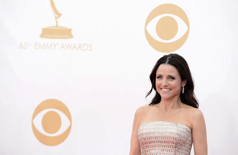 Julia Louis-Dreyfus, wearing Monique Lhuiller, arrives at the 65th Primetime Emmy Awards at Nokia Theatre on Sunday Sept. 22, 2013, in Los Angeles. (Photo by Dan Steinberg/Invision/AP)
