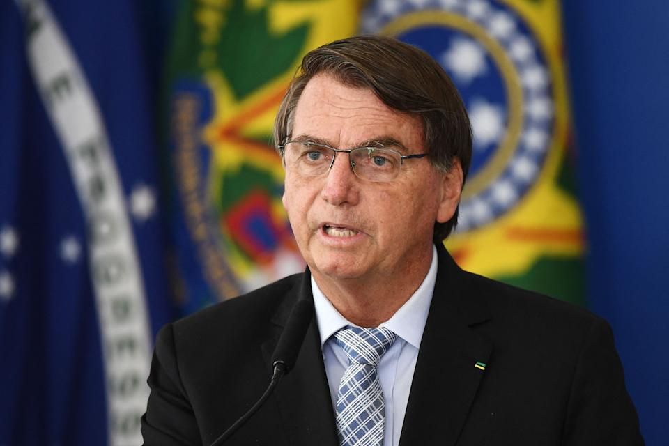 Brazilian President Jair Bolsonaro speaks during the sanction of the law that authorizes states, municipalities and the private sector to buy vaccines against COVID-19, at the Planalto Palace in Brasilia, on March 10, 2021. - Until now, with more than 260,000 deaths by the coronavirus, only the federal Government was authorized to buy vaccines. (Photo by EVARISTO SA / AFP) (Photo by EVARISTO SA/AFP via Getty Images)