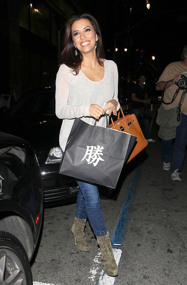 Eva certainly looked happy -- and she should be! Not only is she out with a hunk like Mario, she's about to feast on some delicious sushi from a swanky eatery! (1/31/2012)
