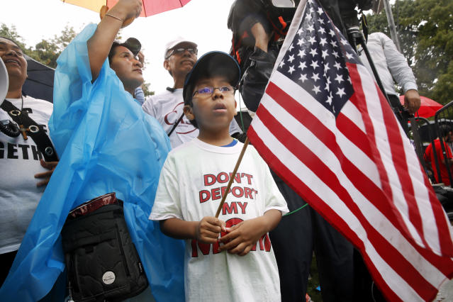 <p>Michael Claros, 8, of Silver Spring, Md., attends a rally in favor of immigration reform, Tuesday, Aug. 15, 2017, at the White House in Washington. The 8-year-old is a U.S. citizen whose parents would have been eligible for DAPA, or Deferred Action for Parents of Americans, an Obama-era policy memo that the Trump administration has since formally revoked. The protesters are hoping to preserve the program known as Deferred Action for Childhood Arrivals, or DACA. The Trump administration has said it still has not decided the DACA program's fate. (Photo: Jacquelyn Martin/AP) </p>