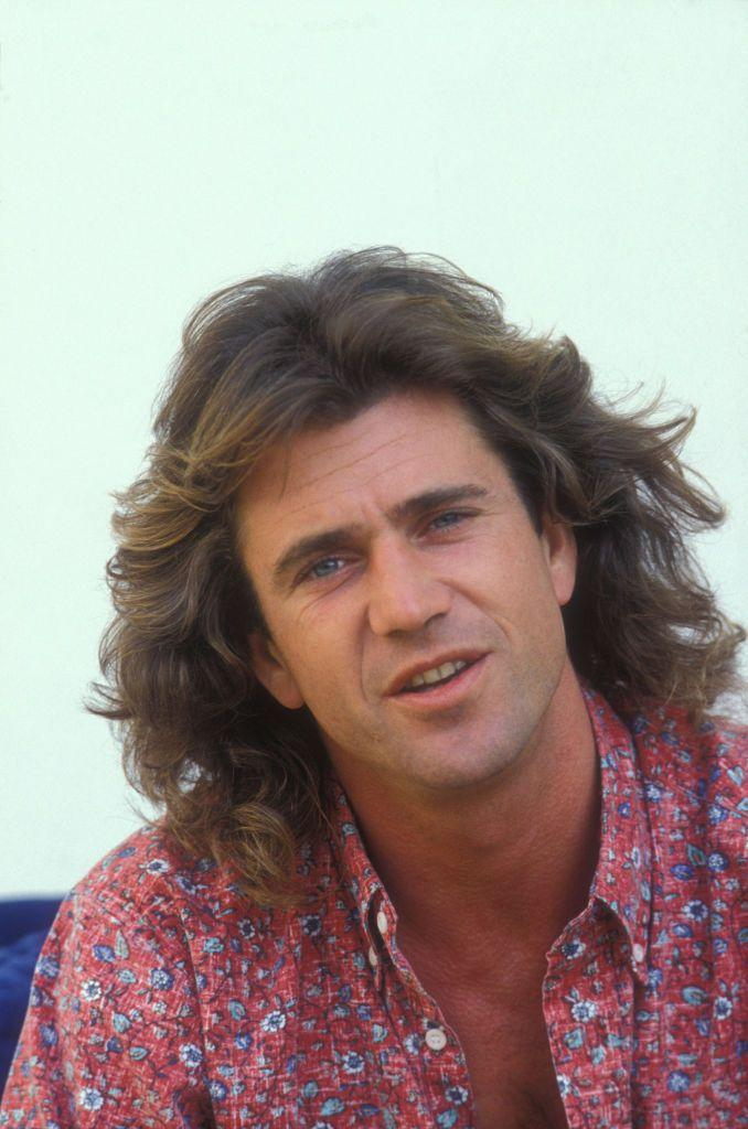 <p>Mel Gibson nailed the California surfer look with his long beach waves in 1987. The actor's hairstyle may have something to do with his reprised role in the <em>Lethal Weapon </em>franchise (his character was known for his long hair). </p>