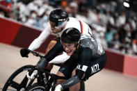 Sam Webster of Team New Zealand and Maximilian Levy of Team Germany, behind, compete during the track cycling men's sprint race at the 2020 Summer Olympics, Thursday, Aug. 5, 2021, in Izu, Japan. (AP Photo/Thibault Camus)