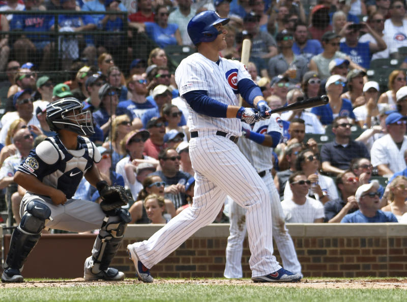 Chicago Cubs' Anthony Rizzo (44) watches his grand slam home run against the San Diego Padres during the third inning of a baseball game, Friday, July,19, 2019, in Chicago. (AP Photo/David Banks)