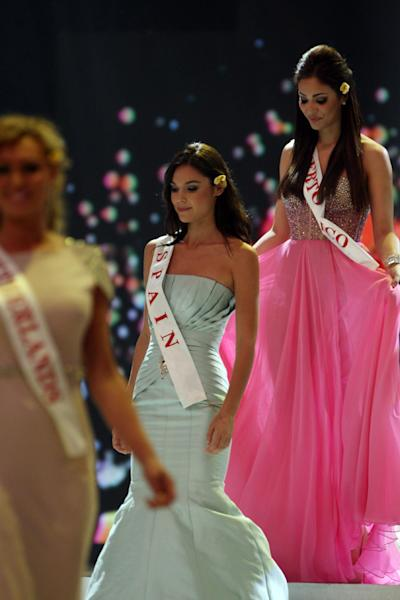 Miss Spain Elena Ibarbia Jimenez, and Miss Puerto Rico Nadyalee Torres walk on stage during the opening of the 63rd Miss World Pageant ceremony in Nusa Dua, Bali, Indonesia on Sunday, Sept. 8, 2013. (AP Photo/Firdia Lisnawati)