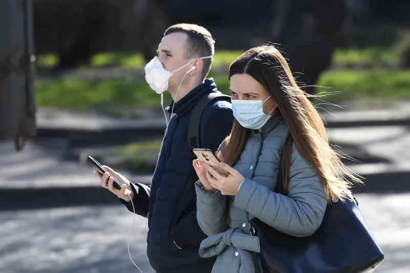 People wearing protective masks as a preventive measure against the coronavirus COVID-19 on street in Kyiv, Ukraine on March 20, 2020. (Photo by Maxym Marusenko/NurPhoto via Getty Images)