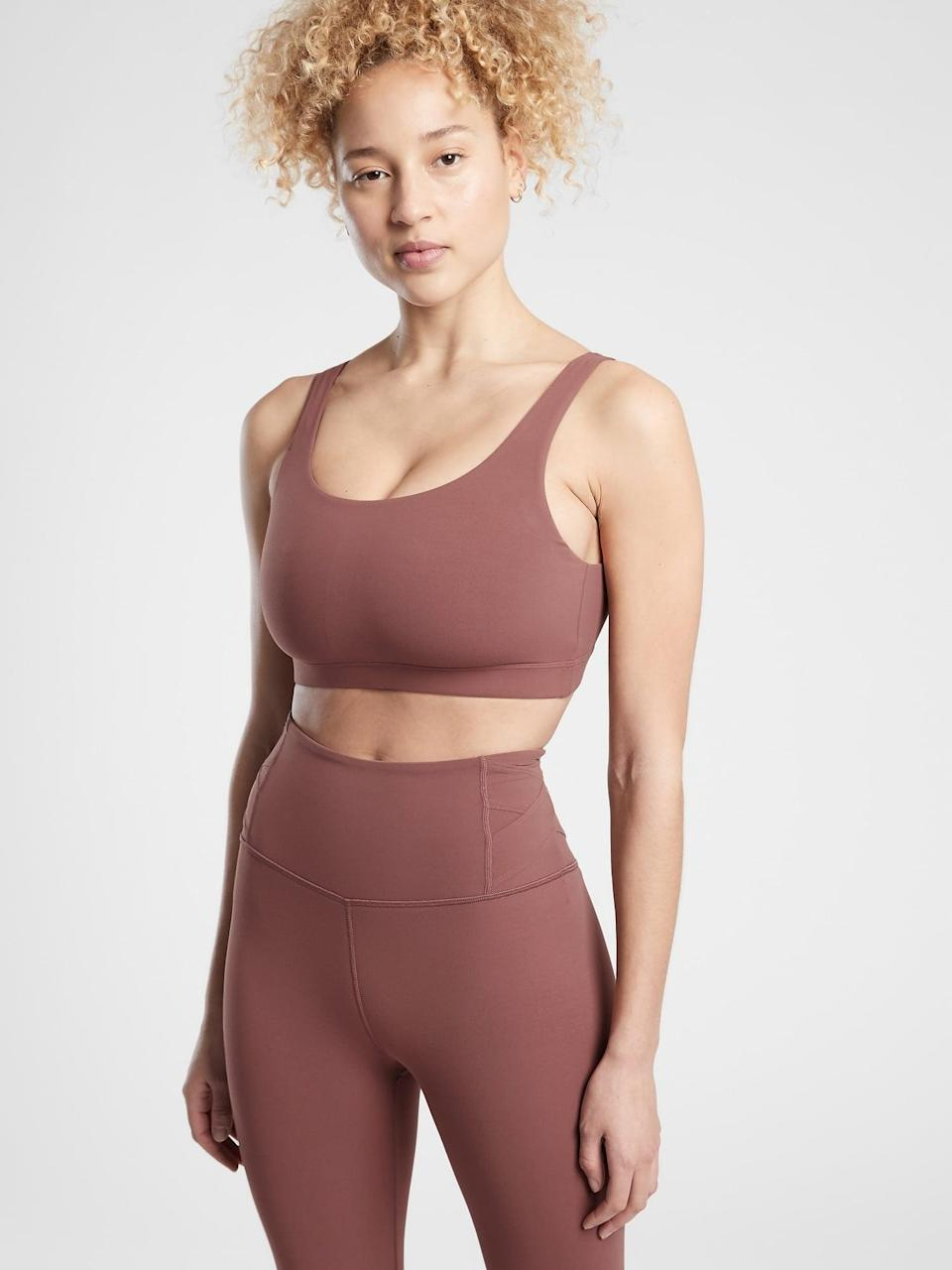 <p>You're going to be obsessed with the fit of this <span>Athleta Exhale Bra D-DD+</span> ($49) and <span>Salutation Stash Pocket II Tight</span> ($98).</p>