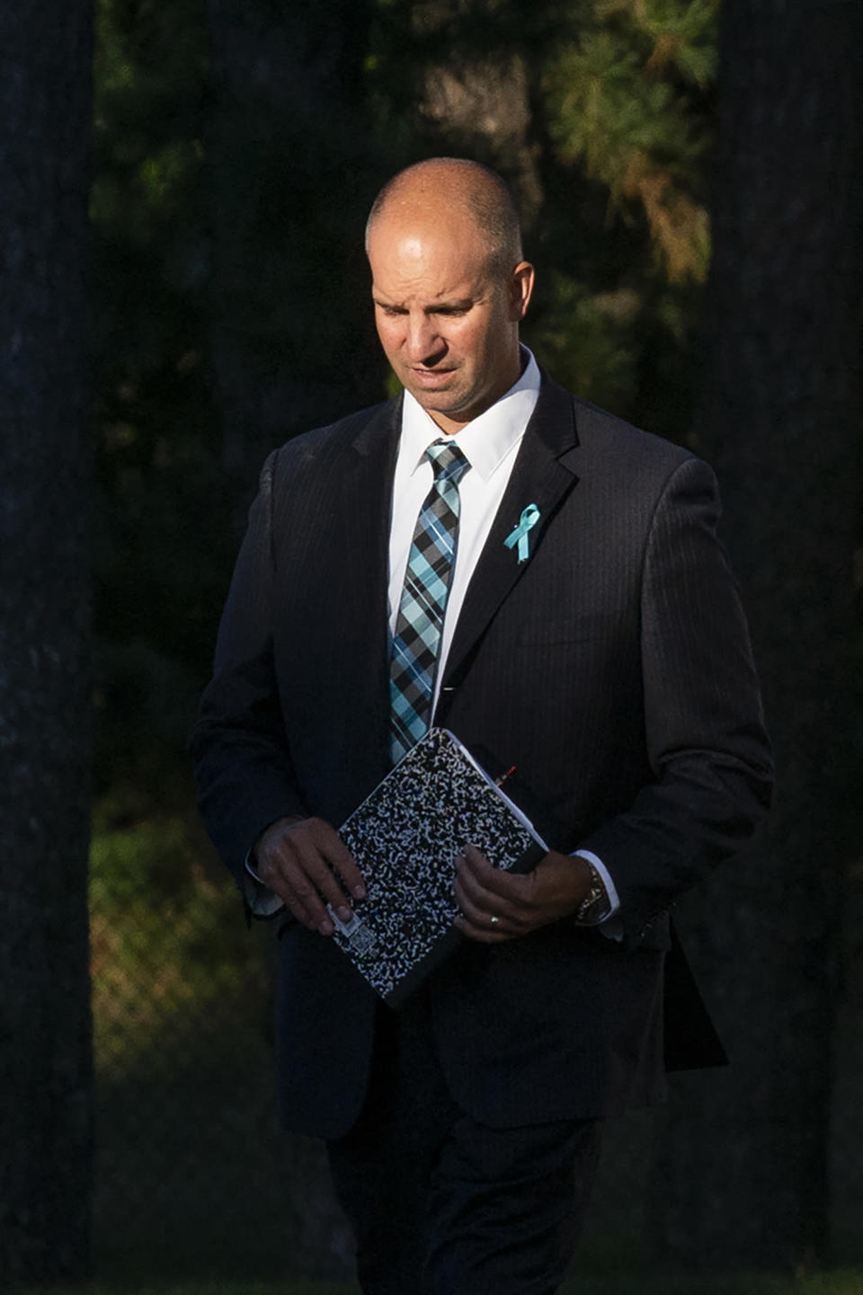 Gabby Petito's stepdad Jim Schmidt, right, walks the end of the funeral home viewing of Gabby Petito at Moloney's Funeral Home in Holbrook, N.Y. Sunday, Sept. 26, 2021. (AP Photo/Eduardo Munoz Alvarez)
