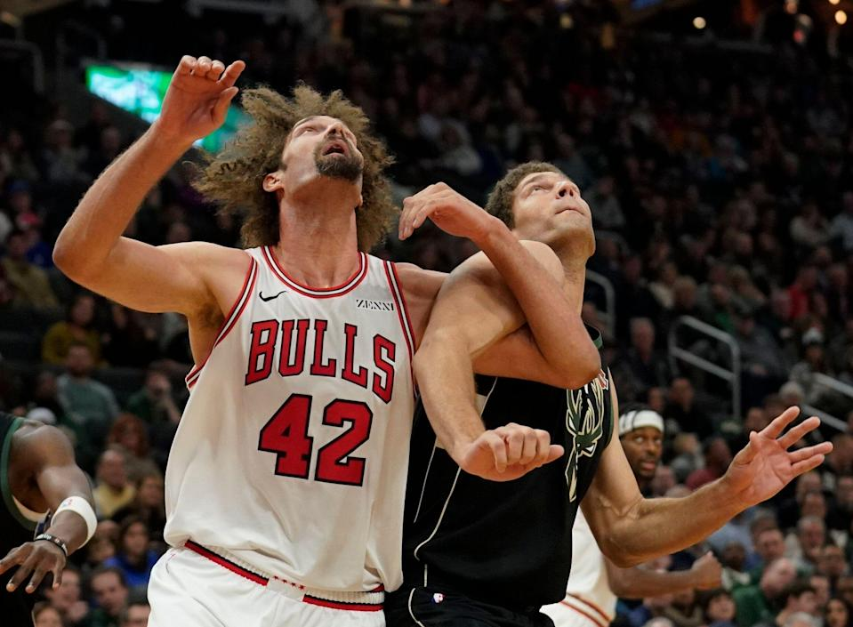 Chicago Bulls' Robin Lopez and Milwaukee Bucks' Brook Lopez battle for a rebound during the second half of an NBA basketball game Friday, Nov. 16, 2018, in Milwaukee. The Bucks won 123-104. (AP Photo/Morry Gash)
