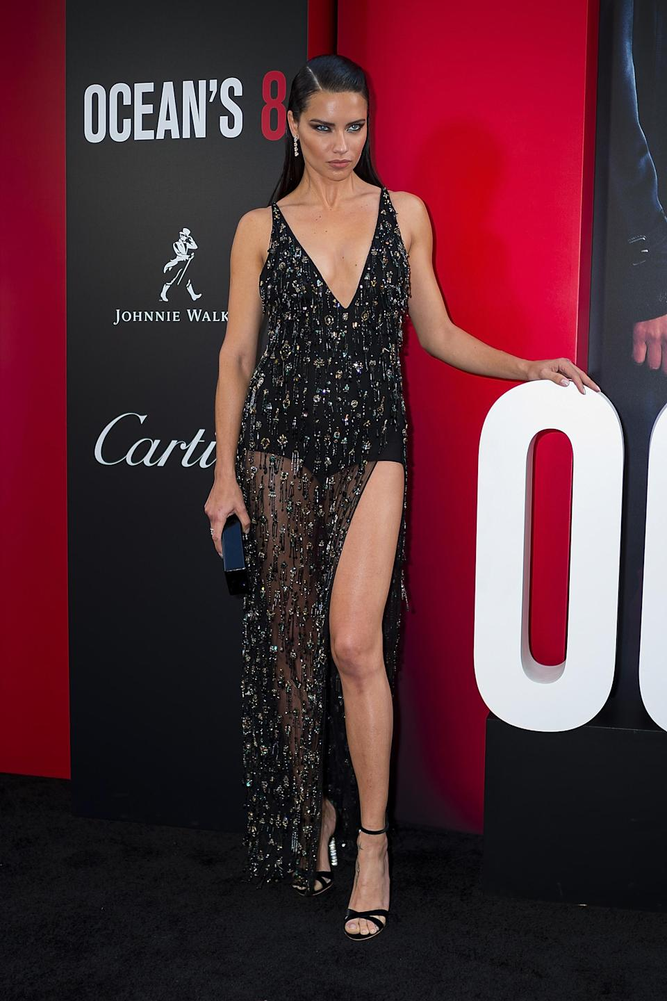 <p>Model Adriana Lima hit the red carpet in a seriously sparkly Roberto Cavalli couture dress accessorised with Chopard jewels. <em>[Photo: Getty]</em> </p>