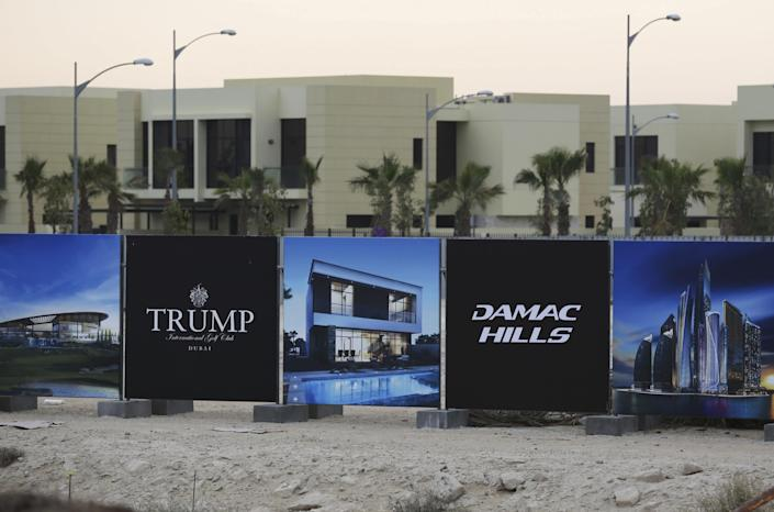 FILE- In this Sunday, Feb. 12, 2017 file photo, a new sign sits on display for the Trump International Golf Club in Dubai, United Arab Emirates. U.S. President Donald Trump's two sons in charge of his business empire will attend a closed-door event to mark the opening of the Trump International Golf Club in Dubai. (AP Photo/Jon Gambrell, File)