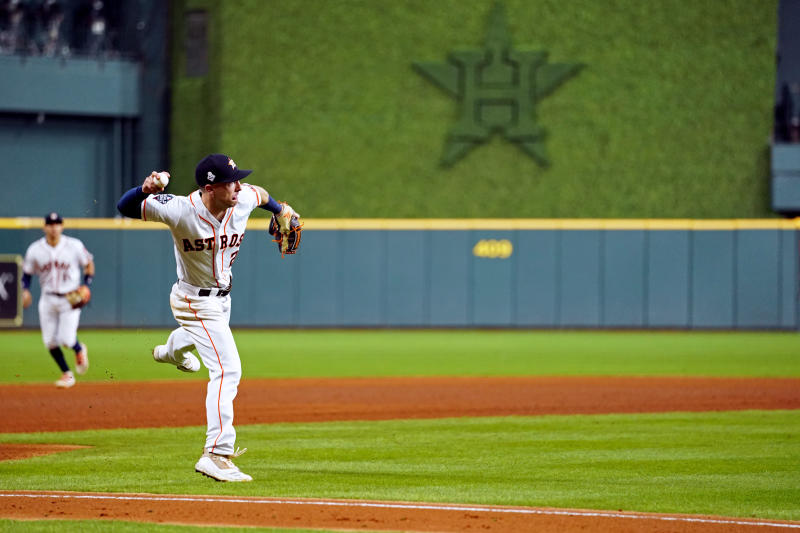 HOUSTON, TX - OCTOBER 23: Alex Bregman #2 of the Houston Astros fields a ground ball but makes a throwing error in the seventh inning during Game 2 of the 2019 World Series between the Washington Nationals and the Houston Astros at Minute Maid Park on Wednesday, October 23, 2019 in Houston, Texas. (Photo by Cooper Neill/MLB Photos via Getty Images)