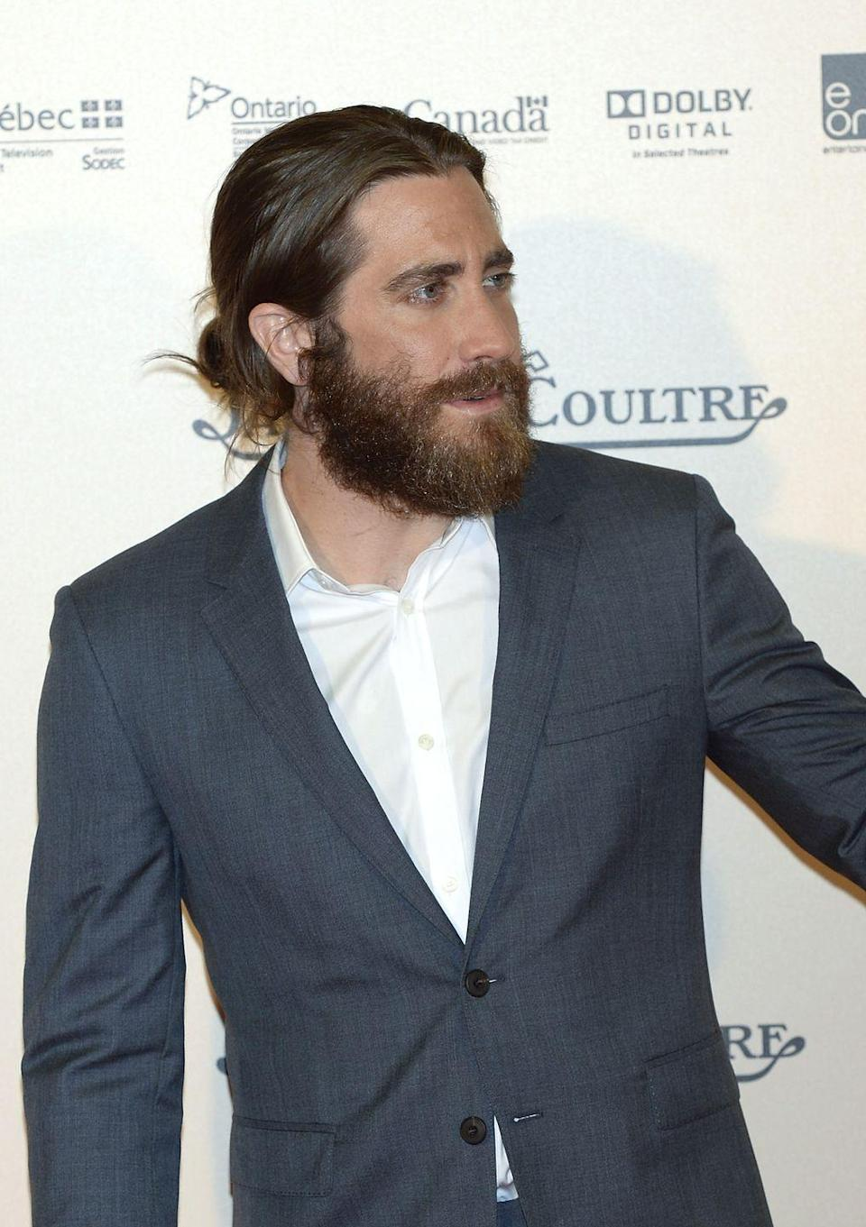 <p>Jake Gyllenhaal normally keeps his hair short, but in 2014 the actor had to grow it past his shoulders for the movie <em>Everest</em>. Gyllenhaal still kept things tidy while on the go and at premieres, favoring the ever-so popular at the time man bun. </p>