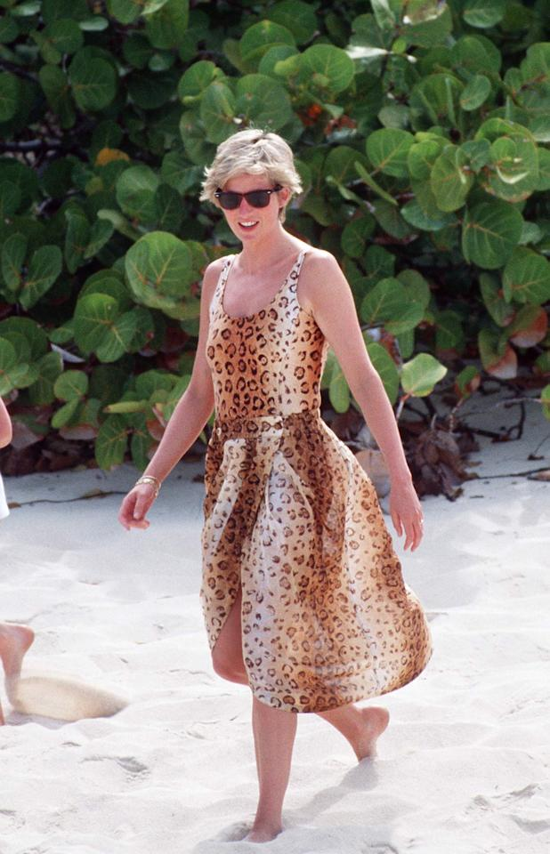 <p>You can barely escape the wrath of animal print this season, with leopard and zebra ruling supreme. Here, Diana wears some leopard print on the beach in the Necker Islands in 1990 – and how effortless does she make it look? <em>[Photo: Getty]</em> </p>