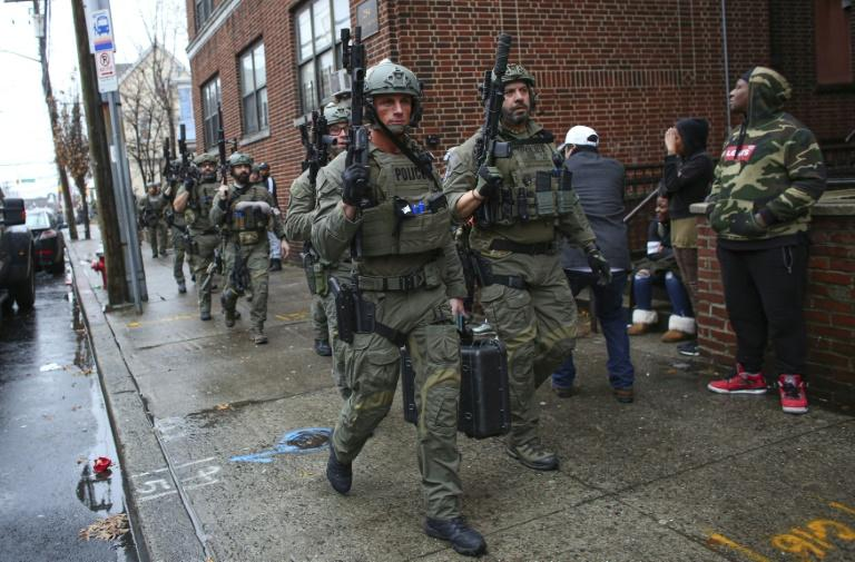 Hundreds of police from New Jersey and New York, including tactical officers, were deployed during the hours-long shooting in Jersey City, New Jersey (AFP Photo/Kena Betancur)