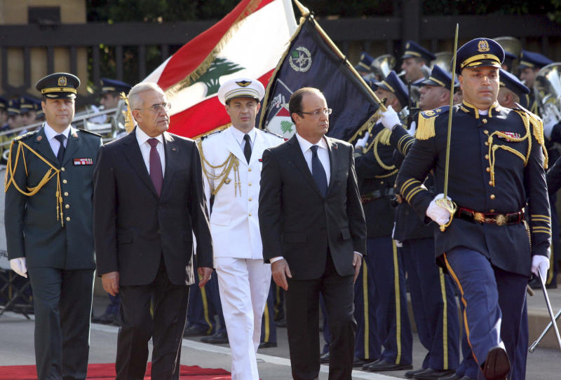 "In this photo released by Lebanon's official government photographer Dalati Nohra, Lebanese President Michel Suleiman, second left, and French President Francois Hollande, second right, review honor guards, at the Presidential Palace in Baabda, east of Beirut, Lebanon, Sunday, Nov. 4, 2012. Hollande said France will stand against instability in Lebanon. Hollande's comments during a short visit to Beirut come as many in Lebanon fear that Syria's civil war could spill over. Speaking to reporters after meeting President Michel Suleiman, Hollande said that amid Syria's civil war, ""we are committed to give you guarantees regarding security, stability and the unity of Lebanon.""  A top anti-Syrian intelligence chief was killed in a car bomb in Beirut last month. The assassination stirred up deadly sectarian tensions in Lebanon, where Sunnis and Shiites are deeply divided over the Syrian civil war, raising the specter of renewed sectarian fighting. (AP Photo/Dalati Nohra)"