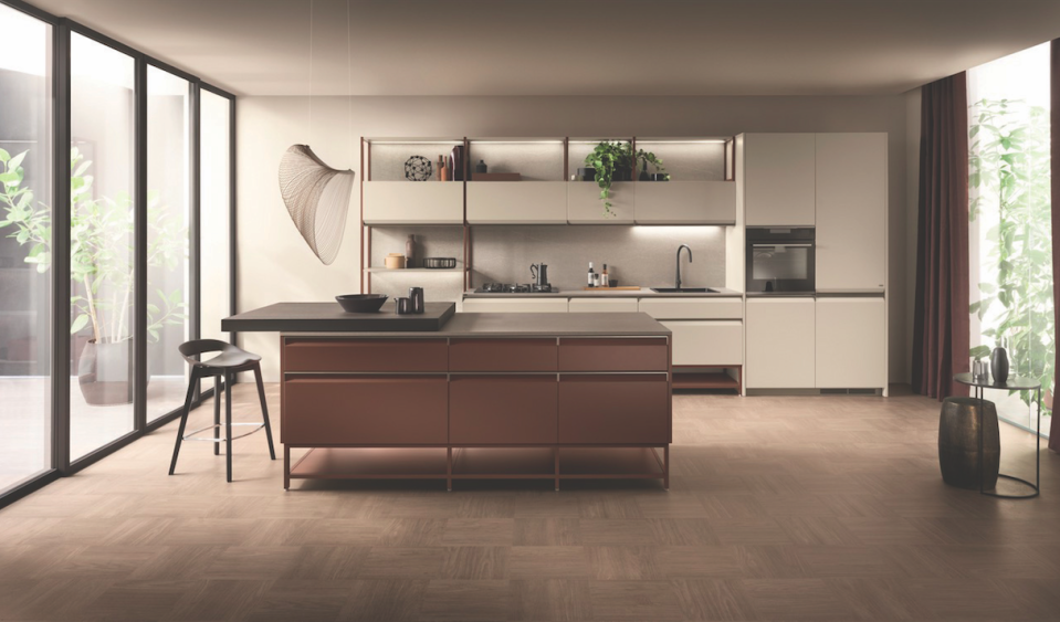 """<p>The Formalia kitchen by Scavolini — in partnership with designer Vittore Niolu — gives a home character and elegance. Formalia truly stands out and keeps up with current trends. A distinguishing feature is the shaped door, featuring a handle at the top that is available in black and titanium. </p><p>Danielle's A-List Anecdote:<em>""""Formalia Kitchen bridges the gap between furniture design and kitchen cabinetry. The most striking aspect is the raised cabinets. There is a lightness by having everything raised off of the floor that you don't generally get with a more bulky, standard kitchen cabinet layout. The sleekness of the beveled door allows for a nice reinterpretation of integrated cabinet pulls.""""</em></p><p><u>Learn More at <a href=""""https://www.scavolini.com/"""" rel=""""nofollow noopener"""" target=""""_blank"""" data-ylk=""""slk:scavoliniusa.com"""" class=""""link rapid-noclick-resp"""">scavoliniusa.com</a>!</u></p>"""